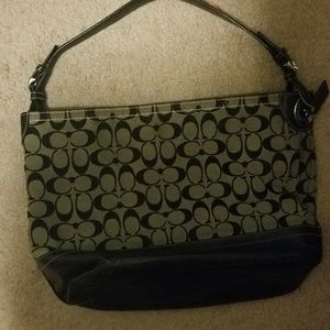 Medium sized designer purse brand new without tags